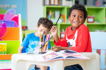 Portrait of mixed race student kids studying in international elementary school. education, mixed...
