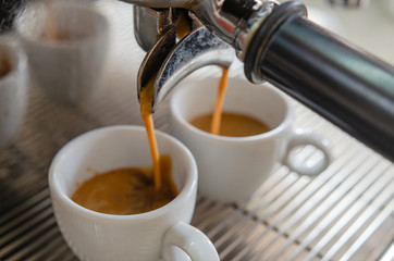 Barista making a cup of coffee soft focus image