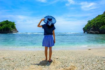 Girl in hat on Teluk Asmara beach, South Malang, Indonesia