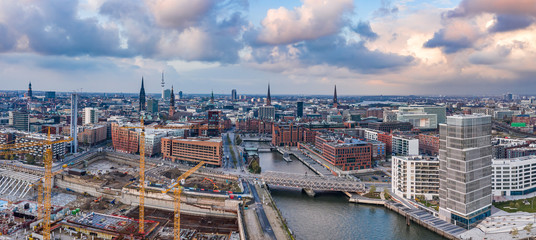 Foto auf Leinwand Schiff Aerial drone panoramic view of port of Hamburg from above before sunset with dramatic stormy clouds over historical city center