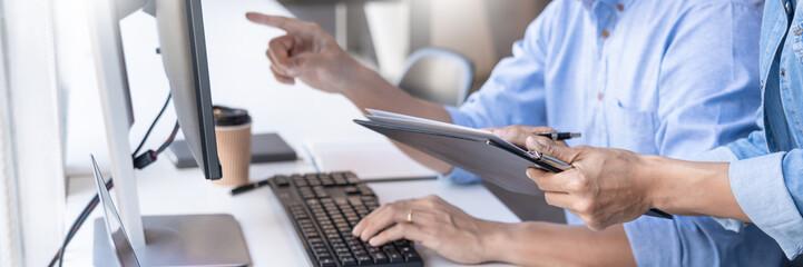 Pensive programmer working on on desktop pc programming code technologies or website design at office Software Development Company