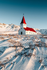 A typical church of Iceland. Very well composited Icelandic church in the beautiful landscape. Gorgeous scenery of the Vik town. Incredible winter behind the arctic circle. Tourism