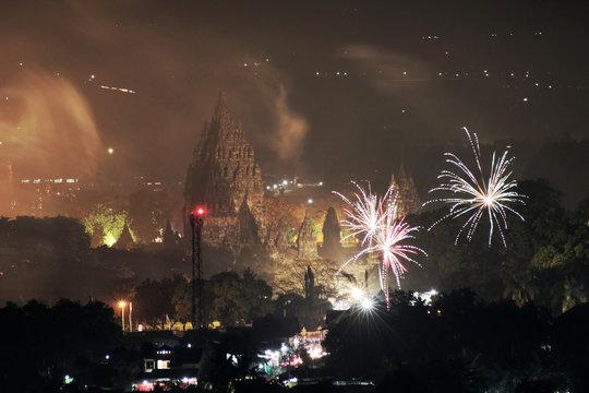 Fireworks explode over Prambanan temple complex during New Year's celebrations in Sleman near Yogyakarta