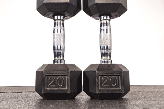 two weights on the floor showing the number 20