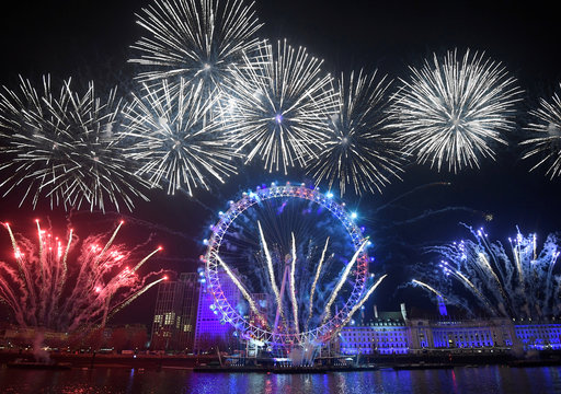 Fireworks explode around the London Eye wheel during New Year celebrations in central London