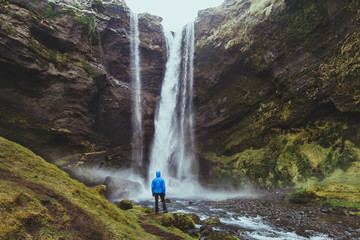 outdoor travel, tourist looking at waterfall landscape in Iceland Wall mural
