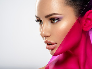 Beautiful white girl with bright eye-makeup. Beautiful fashion woman with  a colored  items.  ...