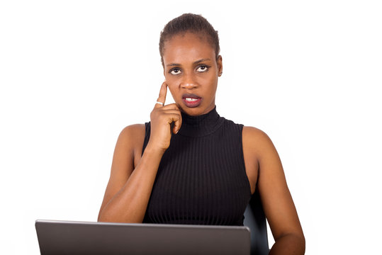 young woman sitting at the office stressed and pensive