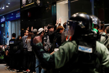 Riot police detain anti-government protesters in a large scale during a legal demonstration on the New Year's Day to call for better governance and democratic reforms in Hong Kong