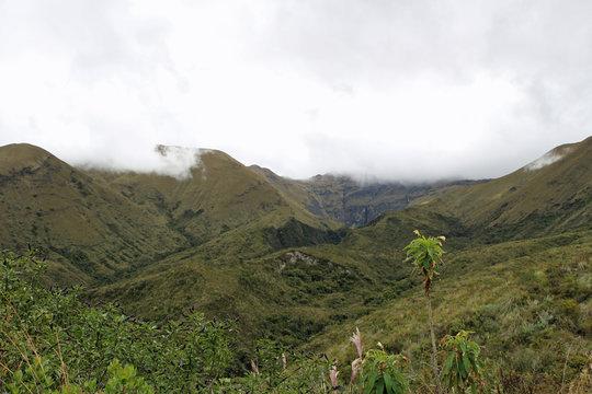 Cloud-covered mountains in Ecuador near crater lake cuicocha
