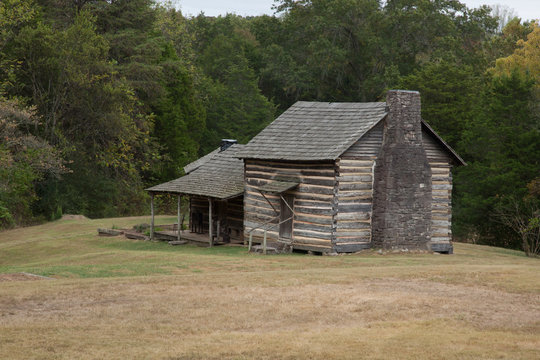 Weathered log cabin with a porch