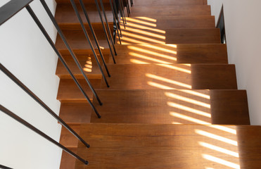 light and shadow on wooden stair steps.