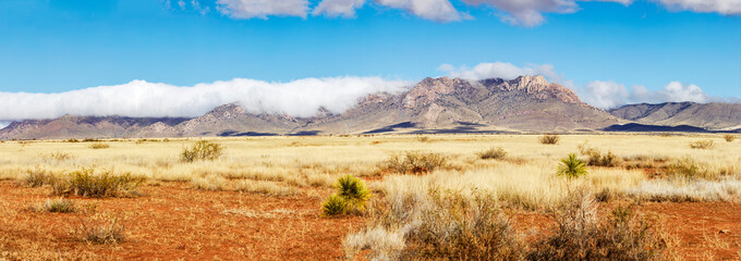 Poster Blauw Low Hanging Clouds over Southern Arizona Mountain Range
