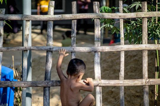 rohingya refugee children playing on the fence of refugee camp in teknaf bangladesh