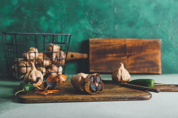 Composition with black garlic on table Wall mural