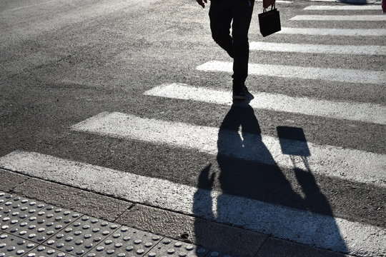Black and white shadows on zebra crossing. Shadows on the asphalt crosswalks