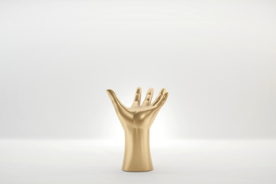 Abstract Gold Hand Holding Mock Up Figure Isolated On White Background, 3D render.