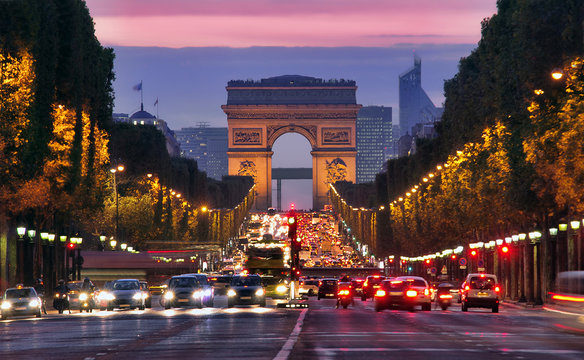 Champs Elysees and Arc de Triomphe in Paris France. night scene with car traffic