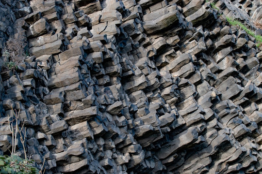 Nature background. Soft focus of geological structure, geological structure, basalt columns
