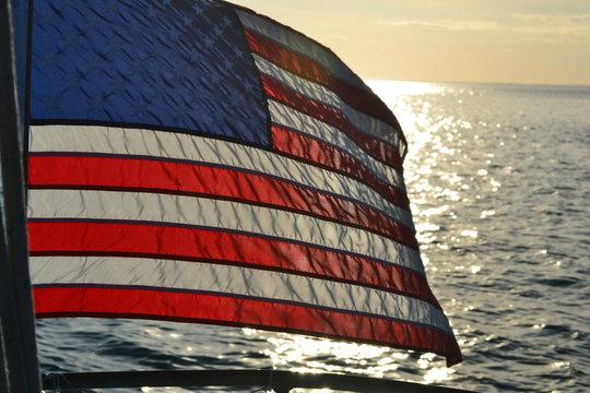 Sailboat American Flag in the sun