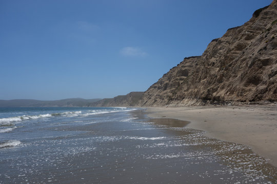 View looking down the scenic, remote Drakes Beach in the Point Reyes National Seashore