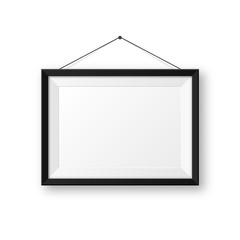 Realistic hanging on a wall blank black picture frame with shadow. Modern poster mockup isolated on white background. Empty photo frame for art gallery or interior. Vector illustration.