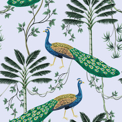 Tropical vintage peacock bird, palm tree and liana floral seamless pattern blue background. Exotic jungle wallpaper.