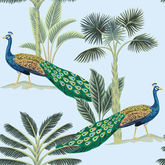 Tropical vintage peacock bird, palm tree and plant floral seamless pattern blue background. Exotic jungle wallpaper.