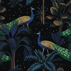 Tropical night vintage peacock bird, palm tree, plant, stars sky floral seamless pattern black background. Exotic dark jungle wallpaper.