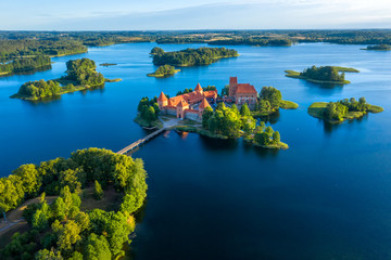 Blue lakes around old castle Trakai in Lithuania aerial view. View from above to Trakai castle Wall mural