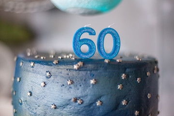 60th birthday cake and candles