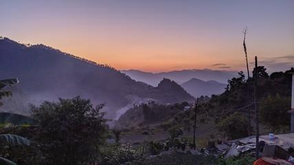 Foto auf Acrylglas Aubergine lila sunset in mountains