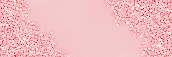 Trendy shining silver candy pink hearts background of cake sprinkles in flat lay with copy space, for feminine blogger or festive love and Valentine's Day concept. Long banner mockup Fototapete