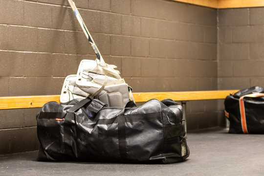 Hockey goalie equipment in locker room