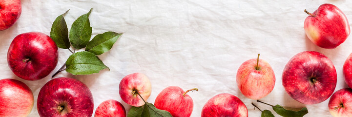 Red Apples on White Fabric