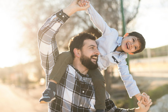father playing with son in outdoors image
