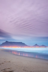 Foto auf Acrylglas Flieder View of Table Mountain at sunrise, Cape Town, South Africa from Milnerton Beach