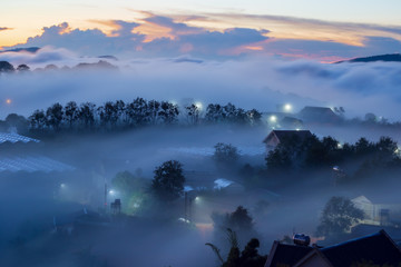 Garden Poster beauty landscape with fresh fog and magical of the sky and clouds cover houses in valley at sunrise, photo use for idea printing, travel design and more