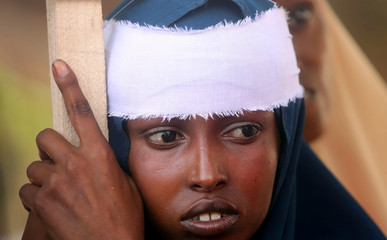 A Somali woman wears a white band on her head as she participates in a protest against al-Shabaab militia over the car bomb explosion at the Afgoye junction, outside the General Kahiye Police Academy in Mogadishu