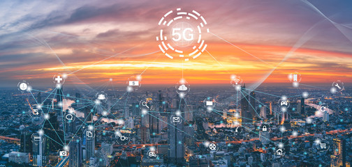 5G network on city background. The wireless communication technology network links work in many branches in smart cities.