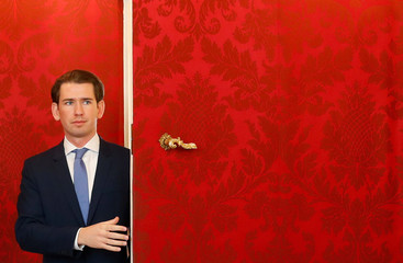 Head of People's Party Sebastian Kurz leaves after his meeting with Austria's President Alexander Van der Bellen and head of the Green Party Werner Kogler at the presidential office in Vienna
