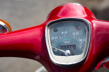 Close up on an old vintage speedometer on a classic scooter.