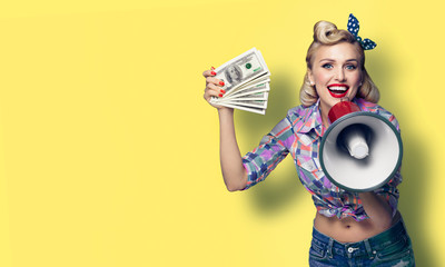 Portrait picture of beautiful pinup girl. Happy excited woman holding cash money banknotes and...
