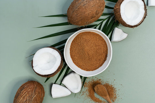 fresh coconuts with brown palm sugar on green background