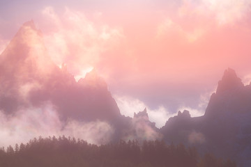 Foto auf Leinwand Rosa hell Fantastic evening snow mountains landscape background. Colorful pink and blue clouds overcast sky. French Alps, Europe