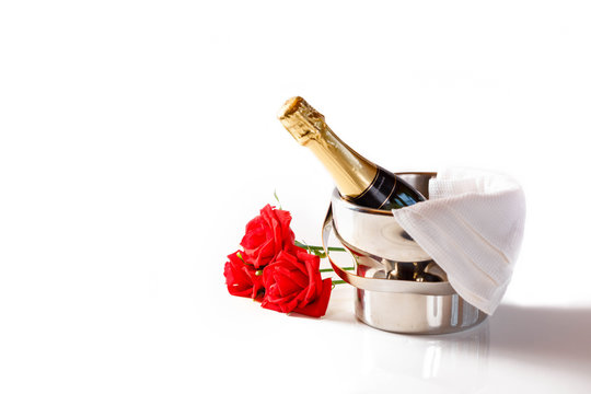 Valentines day concept romantic still life with champagne and red roses on white table