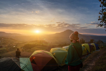 Spoed Foto op Canvas Chocoladebruin Asian woman happy and view relax during dramatic sunrise misty morning,Concept of outdoor camping adventure