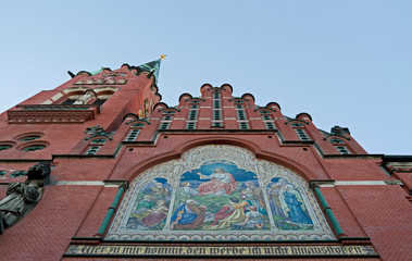 """Altenburg / Germany: East facade of the """"Church of the Brothers"""" with large Sermon on the Mount mosaic, Martin Luther statue, stepped gable and 76 m high steeple"""