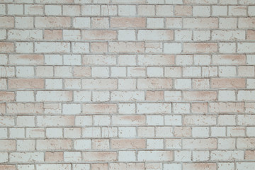 Background.The background of the brick wall is red and white.