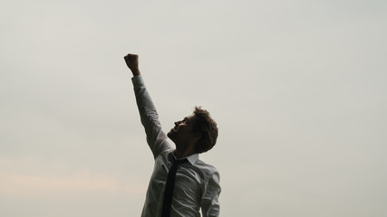 Young businessman celebrating success